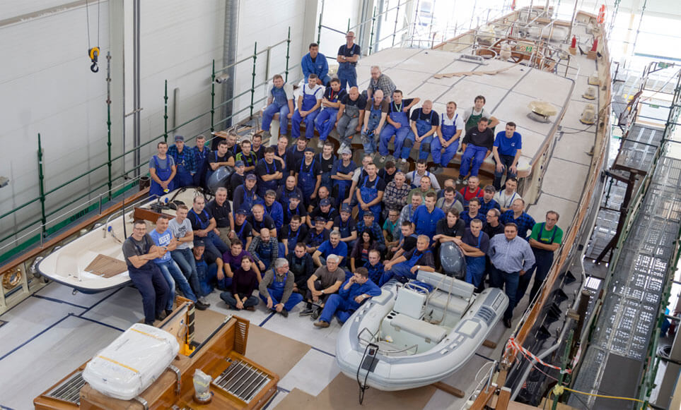 Conrad Production Team picture on deck of Malcolm Miller nearing completion.