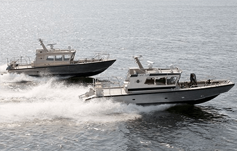 Conrad Cap Series special purpose performance boats planing together at high speeds