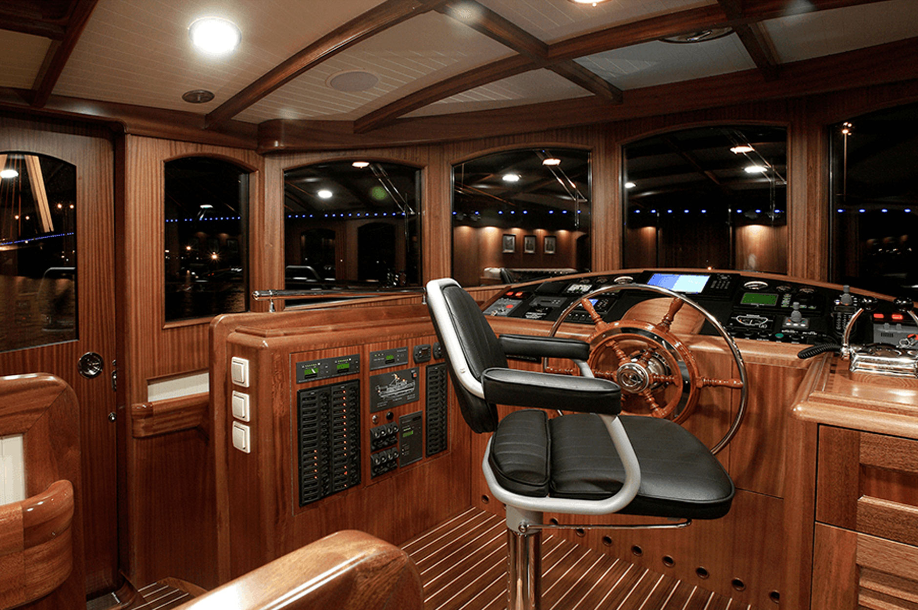 Conrad CC58 Classic Gentleman interior view of the pilothouse's classic wood interiors