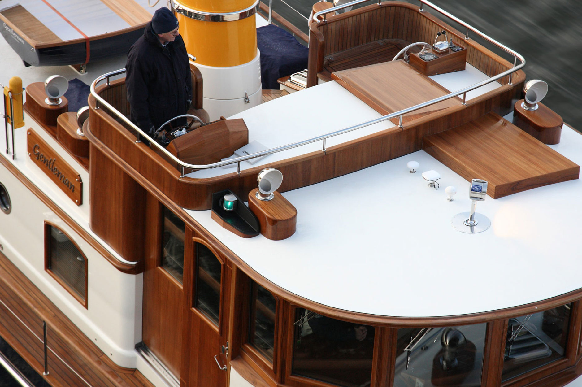 Conrad CC58 Classic M/Y Gentleman bird's-eye view of exterior helm station cruising at sea.